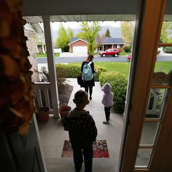 Patricia Abbott Lammi heads out the door with her kids Juliet and Luke on Tuesday, May 2, 2017. Patricia and her husband Phillip juggle their work schedules to make things work with their kids.