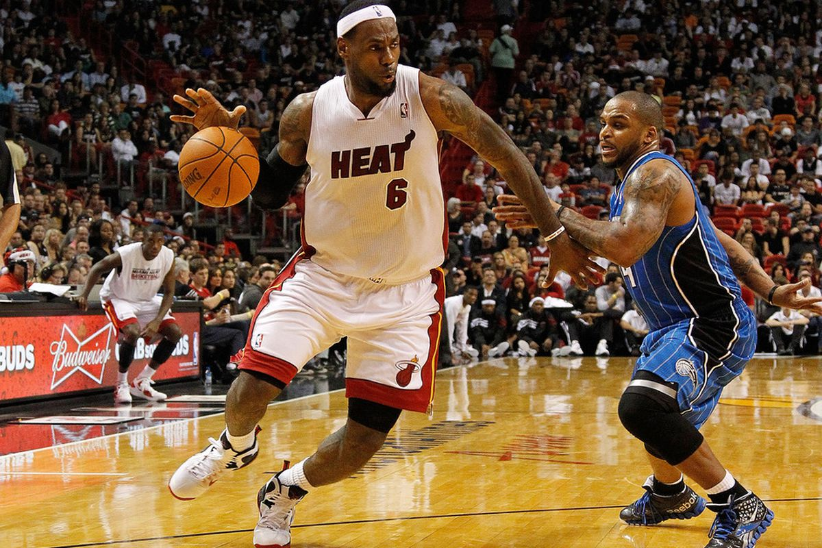 MIAMI, FL - DECEMBER 18:  LeBron James drives against Jameer Nelson during a preseason game at American Airlines Arena  in Miami, Florida. (Photo by Mike Ehrmann/Getty Images)