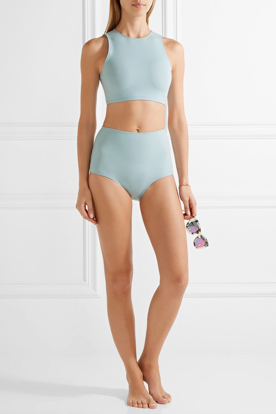 A model wearing a teal bathing suit