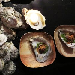 Ashley Christensen's Oysters with creamed turnips, bacon-fat poached oysters, roasted tomato, and Carolina cheddar-cornbread crumbs.