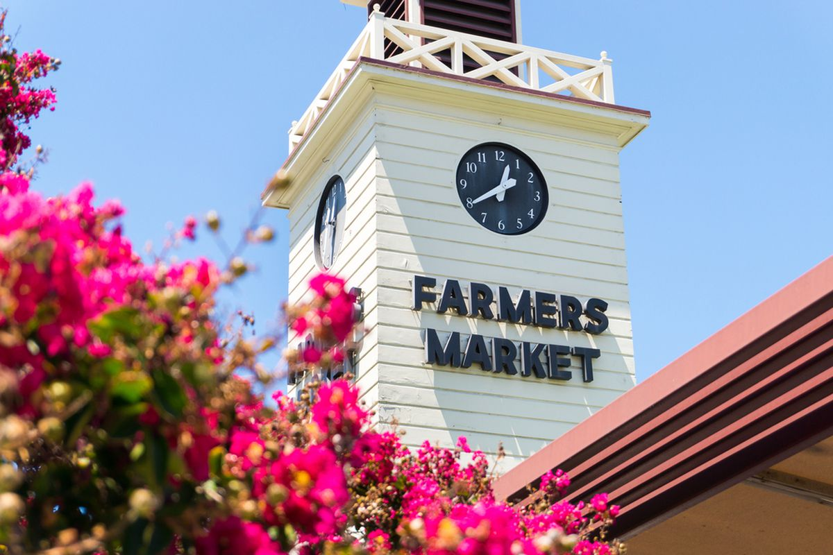 The Farmers Market tower in Los Angeles. The market area offers over a hundred vendors and is open seven days a week.