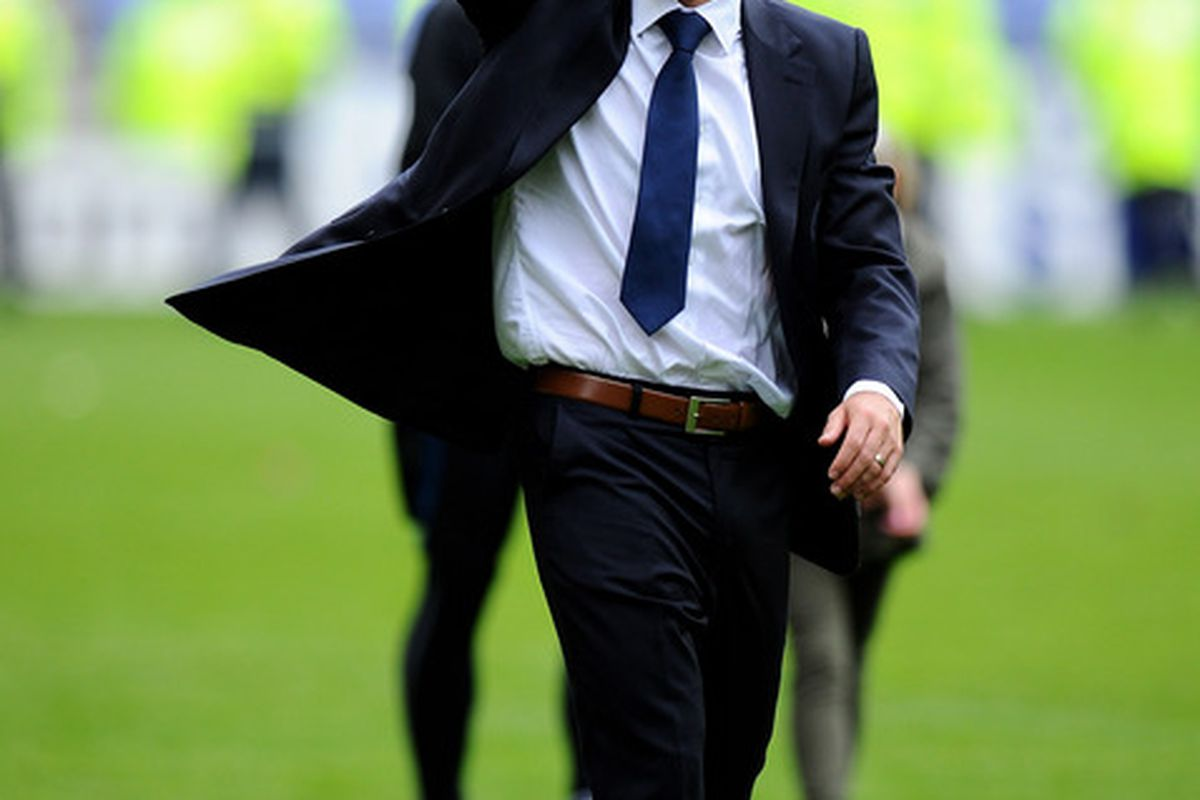Wigan Athletic Manager Roberto Martinez salutes the fans at the end of the Barclays Premier League match between Wigan Athletic and West Ham United at the DW Stadium.