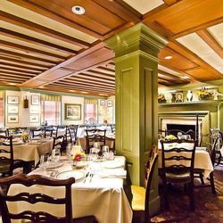 """Each room at 1789 is something to be explored and admired, but the main dining room at the Georgetown restaurant is perhaps its most iconic. Think frame-covered walls, antiques and of course that fireplace.  [Photo: <a href=""""http://underabushel.com""""R. Lop"""