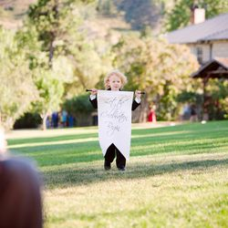 """""""This is my sweet nephew, Campbell, carrying a sign that Ben and I made. He was a show stopper!"""""""