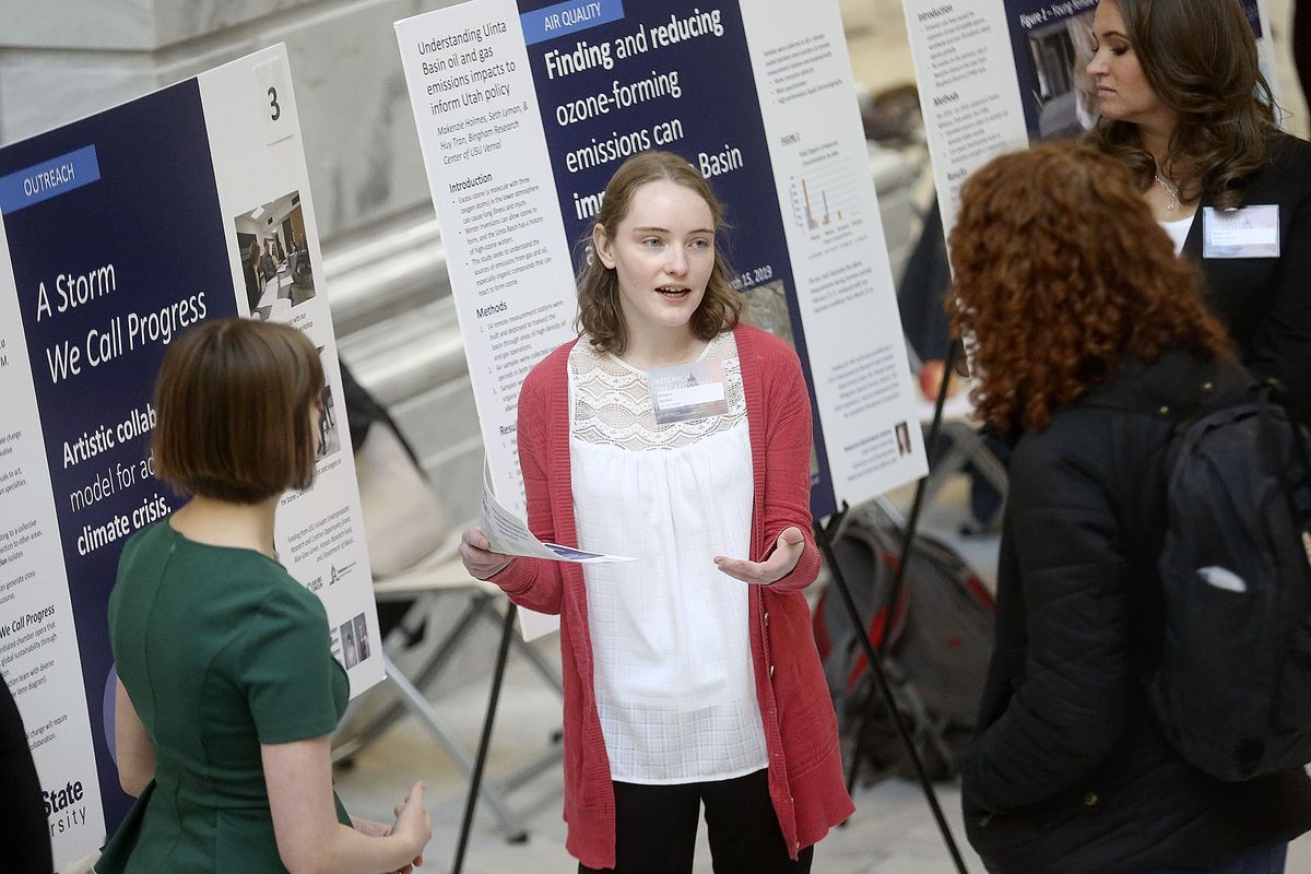 """Utah State University student Kirsten Barker, center, presents climate research titled """"A Storm We Call Progress"""" with Laurana Wheeler Rhoderer, left, during Undergrad Research Day at the Capitol in Salt Lake City on Tuesday, Feb. 18, 2020."""
