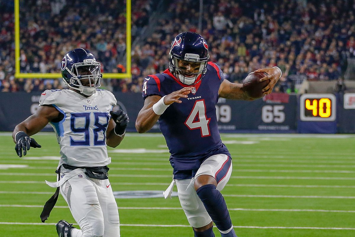 Deshaun Watson of the Houston Texans rushes for a touchdown during the second quarter against the Tennessee Titans at NRG Stadium on November 26, 2018 in Houston, Texas.