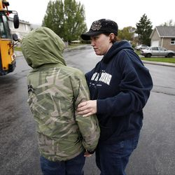 Alyssa Abbott gives last minute admonitions to her son David before he gets on the school bus in Spanish Fork, Wednesday, May 18, 2011.