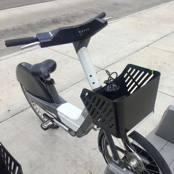 A Summit Bike Share electric bike, with spacious basket up front.