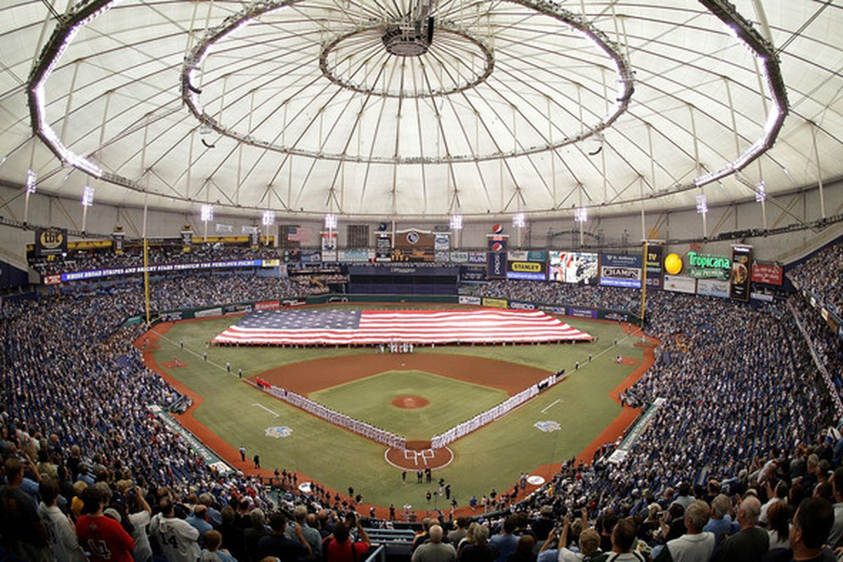 ST PETERSBURG FL - OCTOBER 06:  6: A flag is displayed on the field before Game 1 of the ALDS between the Tampa Bay Rays and the Texas Rangers at Tropicana Field on October 6 2010 in St. Petersburg Florida.  (Photo by Mike Ehrmann/Getty Images)