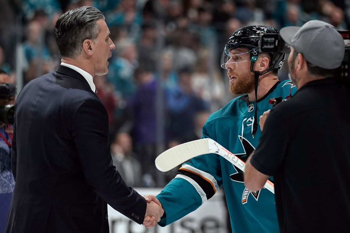 San Jose Sharks center Joe Pavelski (8) shakes hands with Colorado Avalanche head coach Jared Bednar after defeating them in seven of the second round of the 2019 Stanley Cup Playoffs at SAP Center at San Jose.