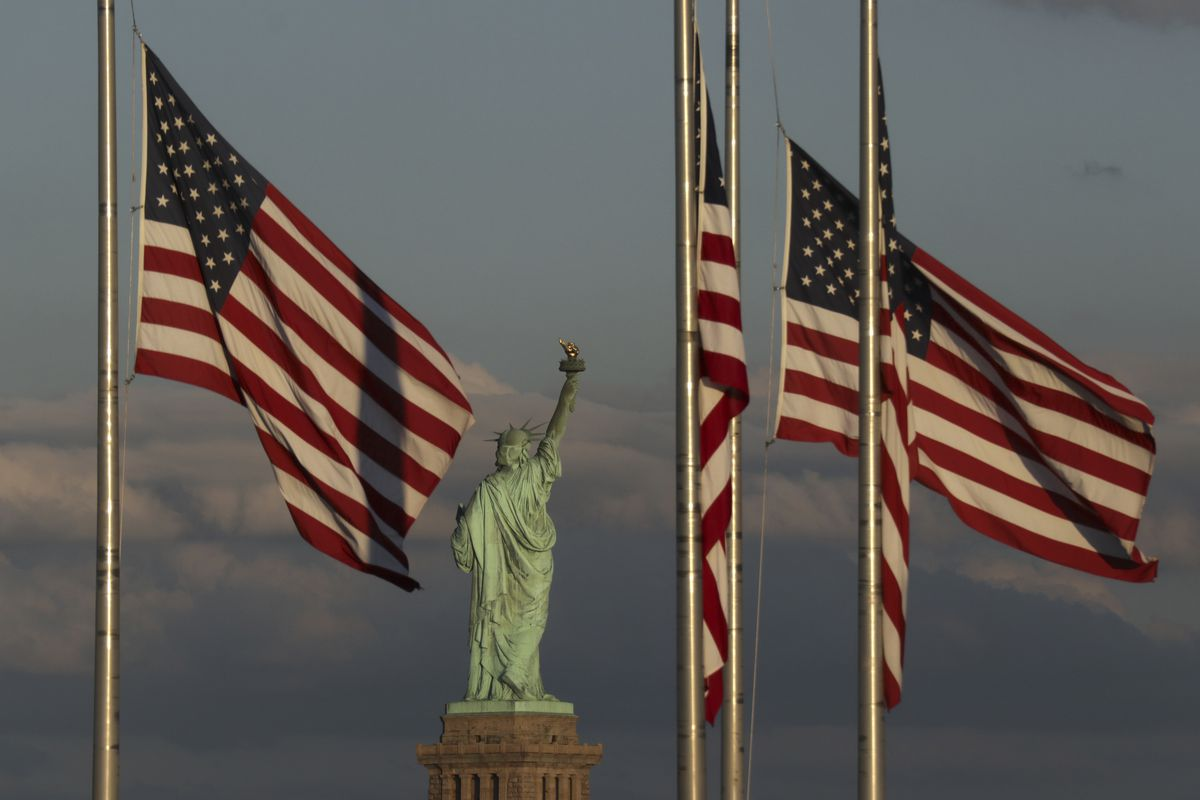 Flags at Half-Staff With the Statue of Liberty