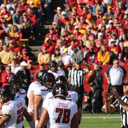 A ball floats to a referee. Seth Collins (22) and Terence Steele (78) are recognizable Red Raiders.