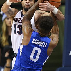 Gonzaga Bulldogs guard Josh Perkins (13) and Brigham Young Cougars guard Jahshire Hardnett (0) get tangled as BYU and Gonzaga play in an NCAA basketball game in the Marriott Center in Provo on Saturday, Feb. 24, 2018. Gonzaga won 79-65.