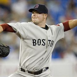 Boston Red Sox pitcher Jon Lester works against the Toronto Blue Jays.