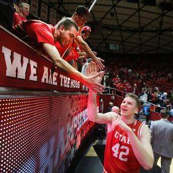 Utah Utes forward Jakob Poeltl (42) celebrates with fans as Utah defeats BYU at the Huntsman Center in Salt Lake City 83-75, Wednesday, Dec. 2, 2015.