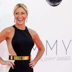Edie Falco arrives at the 64th Primetime Emmy Awards at the Nokia Theatre on Sunday, Sept. 23, 2012, in Los Angeles.