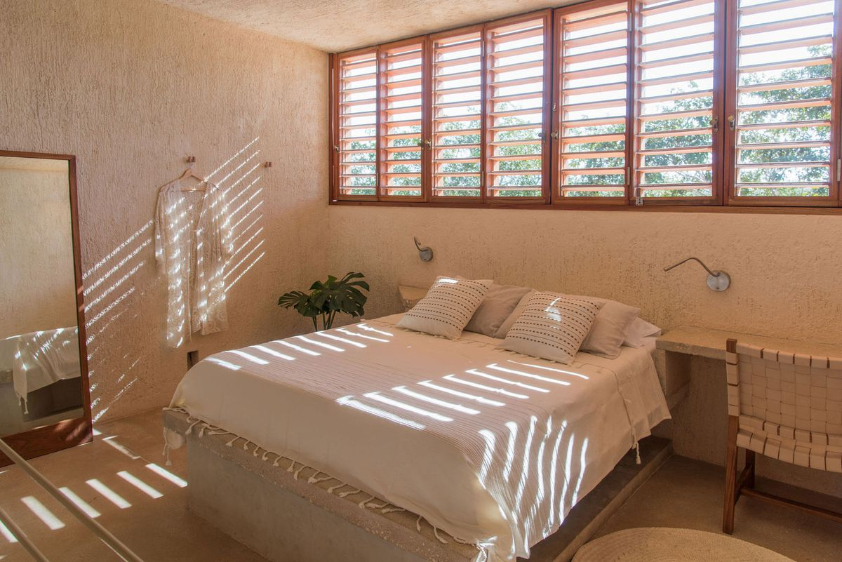 Bedroom with wooden shutters