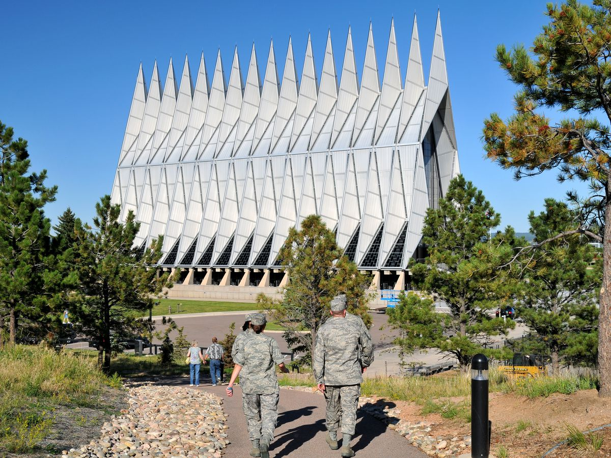 The exterior of the United States Air Force Academy Cadet Chapel. The facade is steel with sharp shapes.