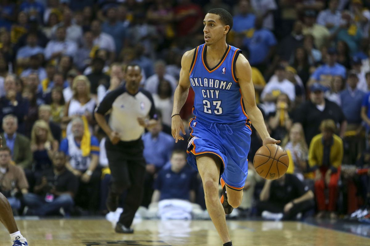 Kevin Martin takes the ball up the floor.