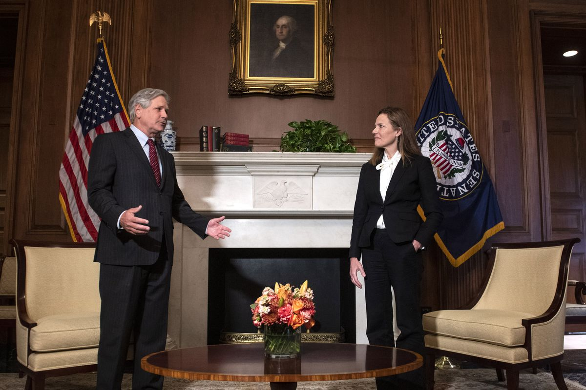 Judge Amy Coney Barrett (right), President Donald Trump's nominee to the Supreme Court, meets with U.S. Sen. John Hoeven, R-North Dakota, during a photo-op at the U.S. Capitol on Oct. 1.