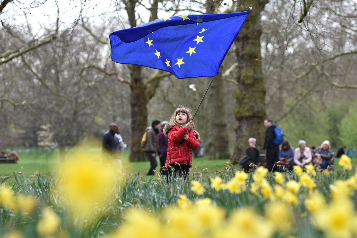A young girl waves an EU flag during the People's Vote anti-Brexit march in London on March 23, 2019.