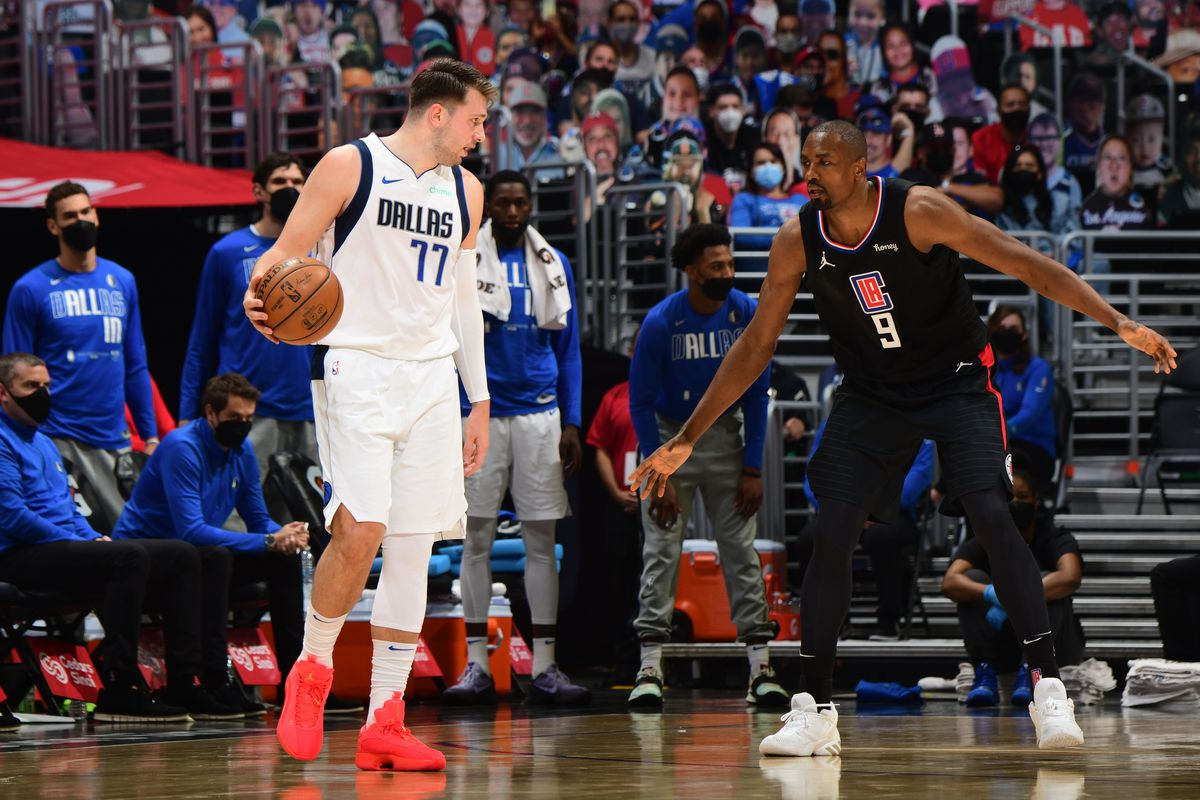 Serge Ibaka #9 of the LA Clippers plays defense on Luka Doncic #77 of the Dallas Mavericks during Round 1, Game 2 of the 2021 NBA Playoffs on May 25, 2021 at STAPLES Center in Los Angeles, California.