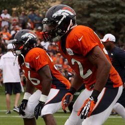 Broncos linebackers Nate Irving (left) and Wesley Woodyard (right) set up during linebacker drills