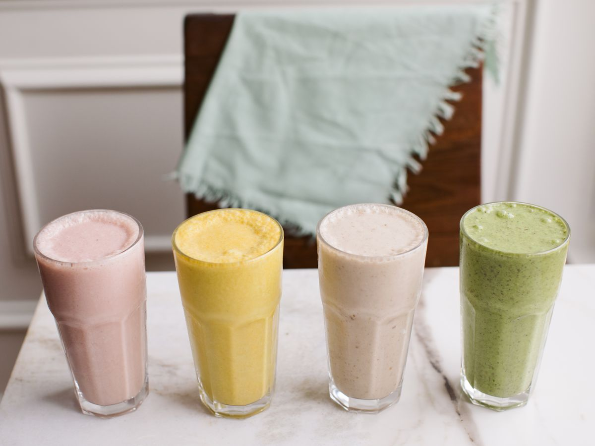 Four smoothies in glasses on a table