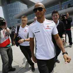 McLaren Formula One driver Lewis Hamilton of Britain arrives at the circuit for the China Formula One Grand Prix in Shanghai, China, Thursday, April 12, 2012.
