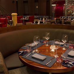 One of the booths in the main dining room at Gordon Ramsay Steak.