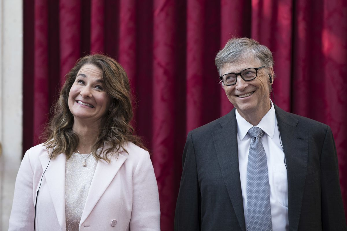 Philanthropist and co-founder of Microsoft, Bill Gates, right, and his wife Melinda react, prior to being awarded the Legion of Honour at the Elysee Palace in Paris.