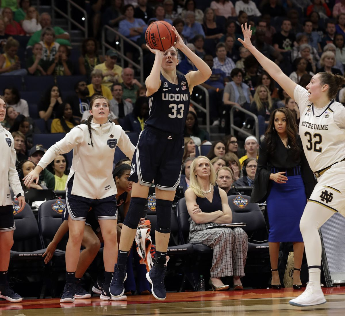 Connecticut guard Katie Lou Samuelson (33) attempt a 3-point shot as Notre Dame forward Jessica Shepard (32) defends during the second half of a Final Four semifinal of the NCAA women's college basketball tournament Friday, April 5, 2019, in Tampa, Fla. |