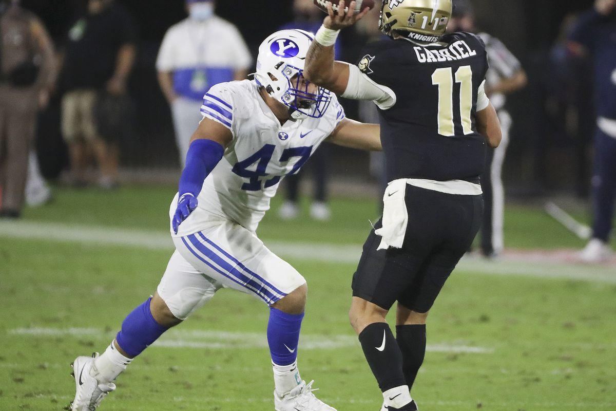 Brigham Young Cougars linebaker Pepe Tanuvasa hurries UCF Knights quarterback Dillon Gabriel (11) during the Boca Raton Bowl in Boca Raton, Fla., on Tuesday, Dec. 22, 2020.