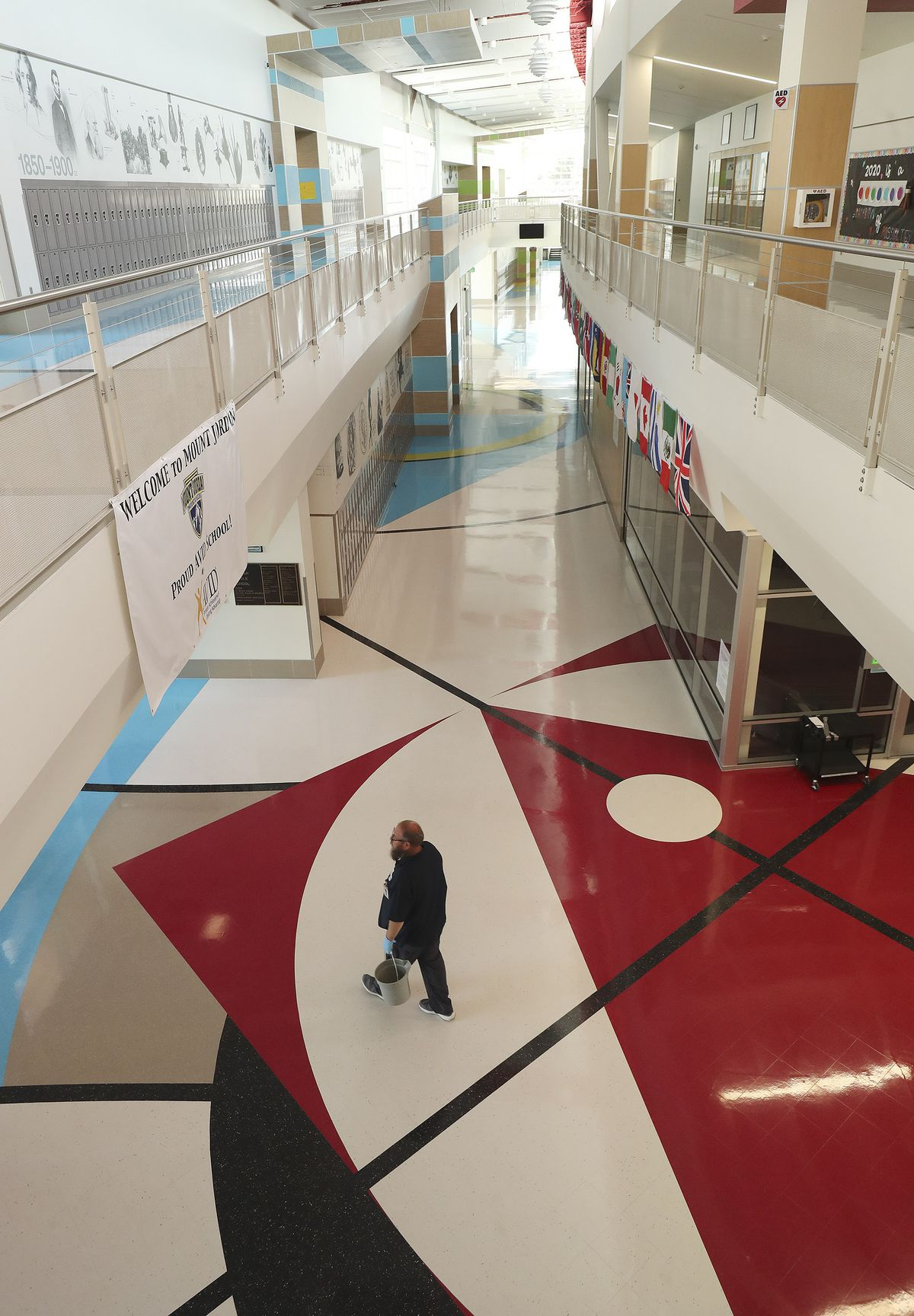 Jessee Osborne, lead custodian at Mount Jordan Middle School in Sandy, walks through the school's empty hallson Tuesday, April 14, 2020. Utah's K-12 public schools will remain closed for in-person learning for the remainder of the academic year, state officials announced Tuesday.