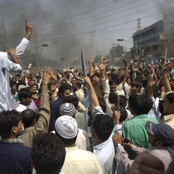 Pakistani protesters shout anti-U.S. slogans at a rally in Rawalpindi, Pakistan on Friday, Sept. 21, 2012. Pakistan has blocked cell phone service in major cities to prevent militants from using phones to detonate bombs during a national day of protest against an anti-Islam film produced in the United States.