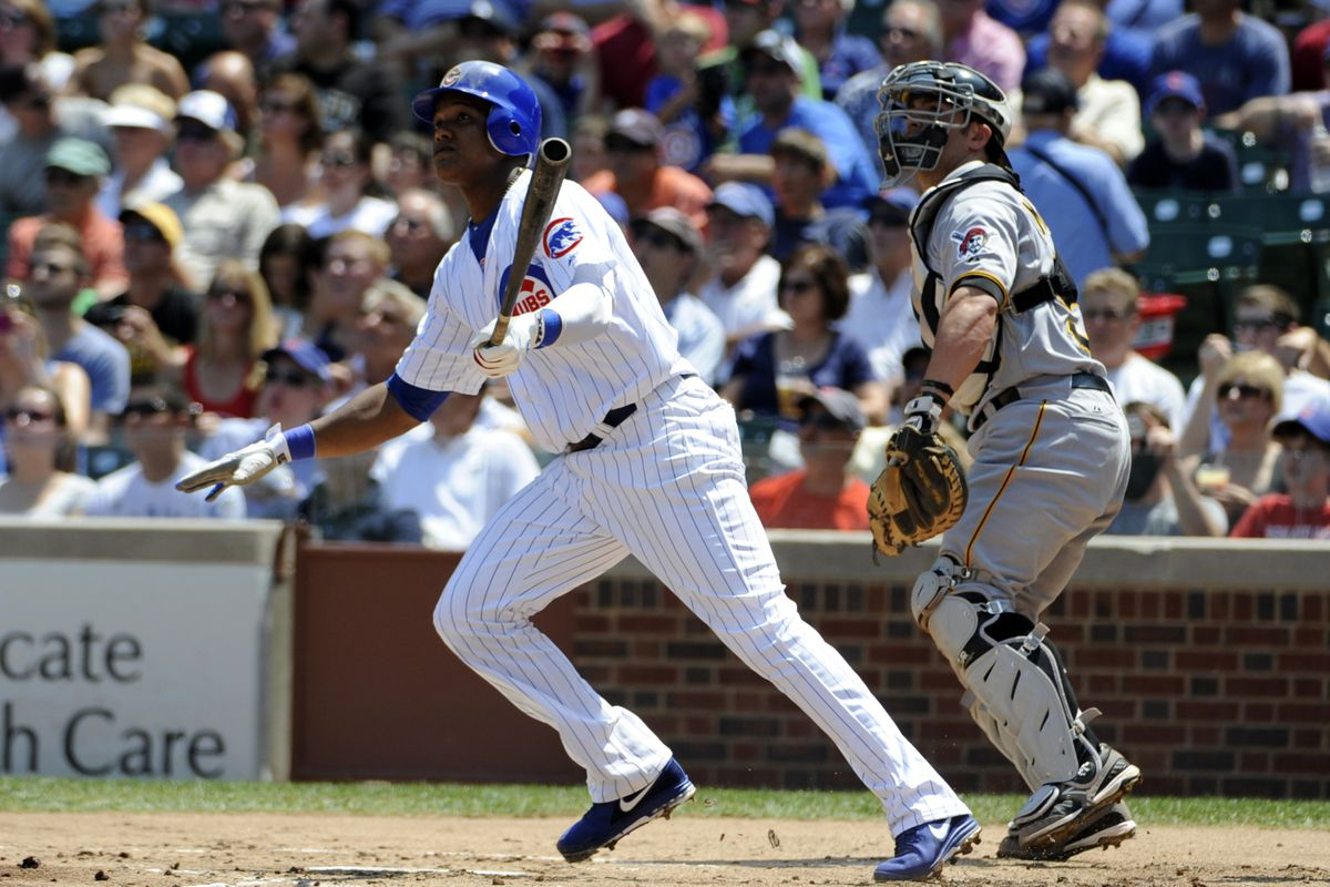 CHICAGO, IL - AUGUST 01: Starlin Castro #13 of the Chicago Cubs hits a home run in the first inning against the Pittsburgh Pirates  on August 1, 2012 at Wrigley Field in Chicago, Illinois.  (Photo by David Banks/Getty Images)