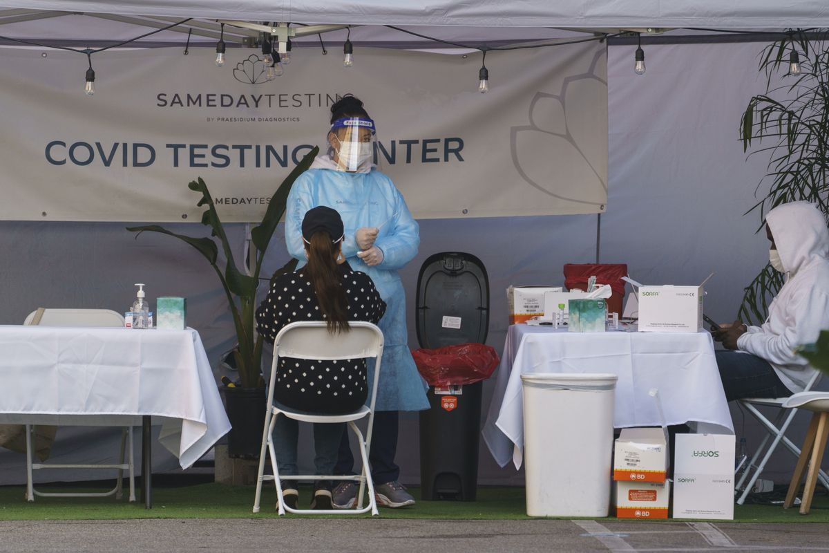 A mid-turbinate nasal swab PCR test is administered at a same-day coronavirus testing site in Los Angeles on Tuesday, Jan. 5, 2021.