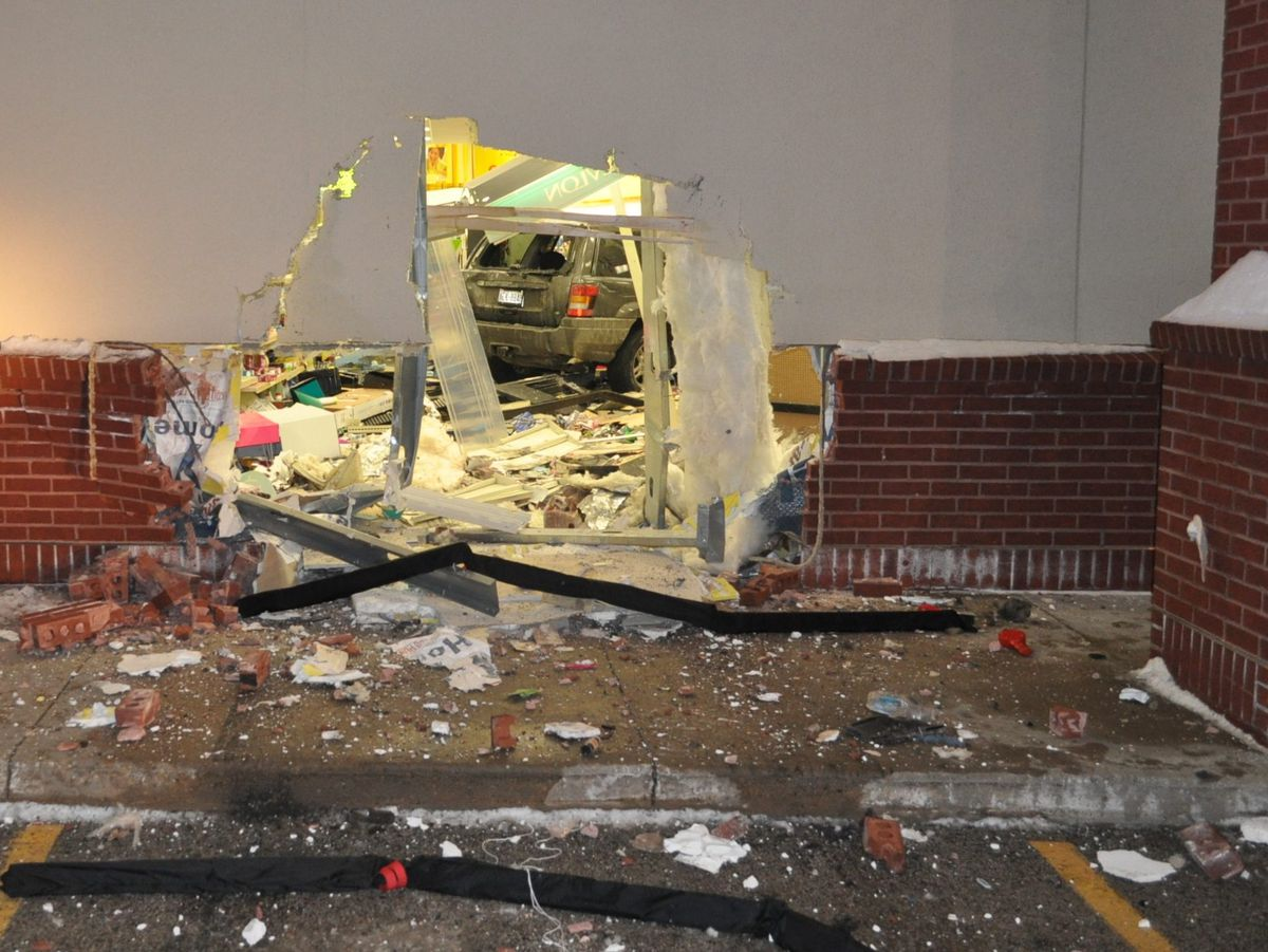 A woman drove her SUV through a wall of a Zion CVS Friday evening. | Zion police
