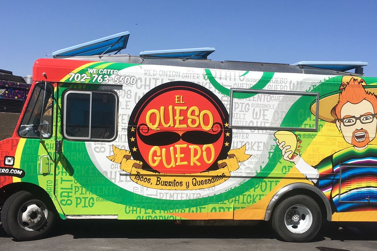 A food truck with a man wearing a sombrero and poncho as a logo