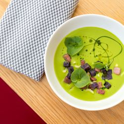 chilled spring onion soup with purple potatoes, ham, and pickled celery
