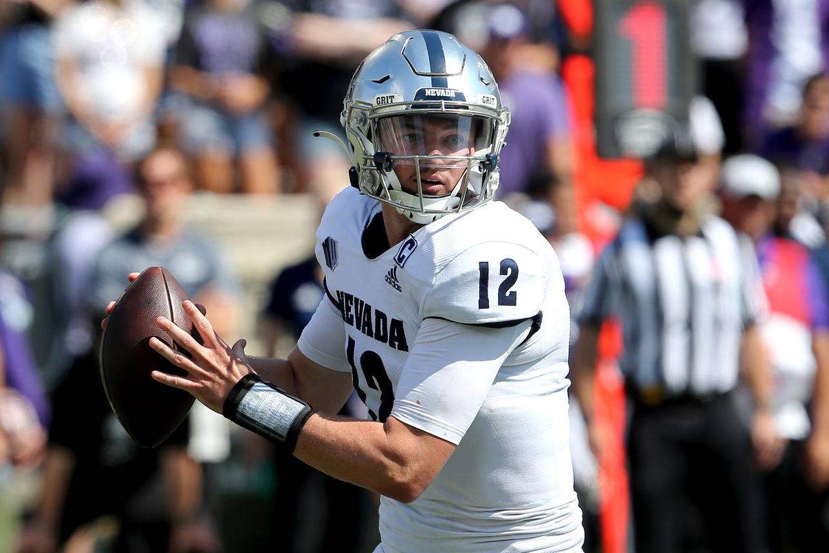 Nevada Wolf Pack quarterback Carson Strong (12) drops back to pass during the first quarter against the Kansas State Wildcats at Bill Snyder Family Football Stadium.