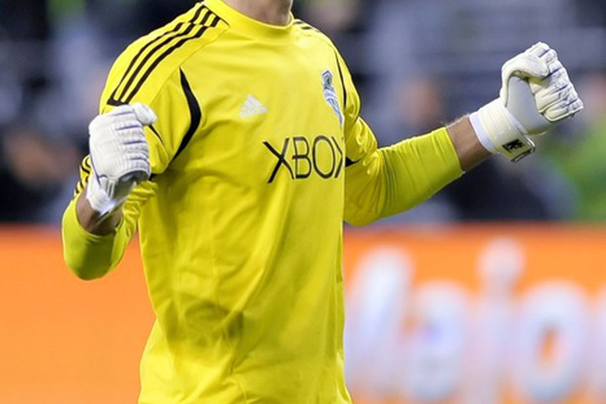 Mar 23, 2012; Seattle, WA, USA; Seattle Sounders FC goalkeeper Michael Gspurning (1) celebrates after the Sounders FC scored a goal against the Houston Dynamo in the 1st half at CenturyLink Field. Mandatory Credit: Steven Bisig-US PRESSWIRE
