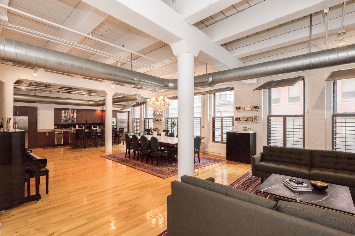 Brick-and-beam Leather District loft features 14-foot ceilings, wine ...