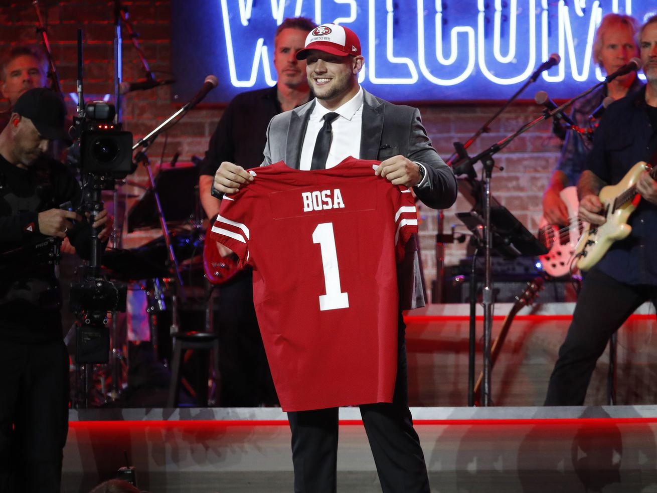 Nick Bosa with his 49ers jersey.