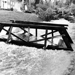 Red Butte Creek rages through the normally serene grounds of the Garden Park Ward chapel in Salt Lake City. April 28, 1983.