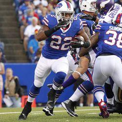 Aug 16, 2013; Orchard Park, NY, USA; Buffalo Bills running back Fred Jackson (22) runs with the ball against the Minnesota Vikings at Ralph Wilson Stadium.