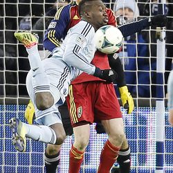 Kansas City's C.J. Sapong tries to kick the ball into the goal as Real's Nat Borchers gets in his way as Real Salt Lake and Sporting KC play Saturday, Dec. 7, 2013 in MLS Cup action. Sporting KC won in a shootout.