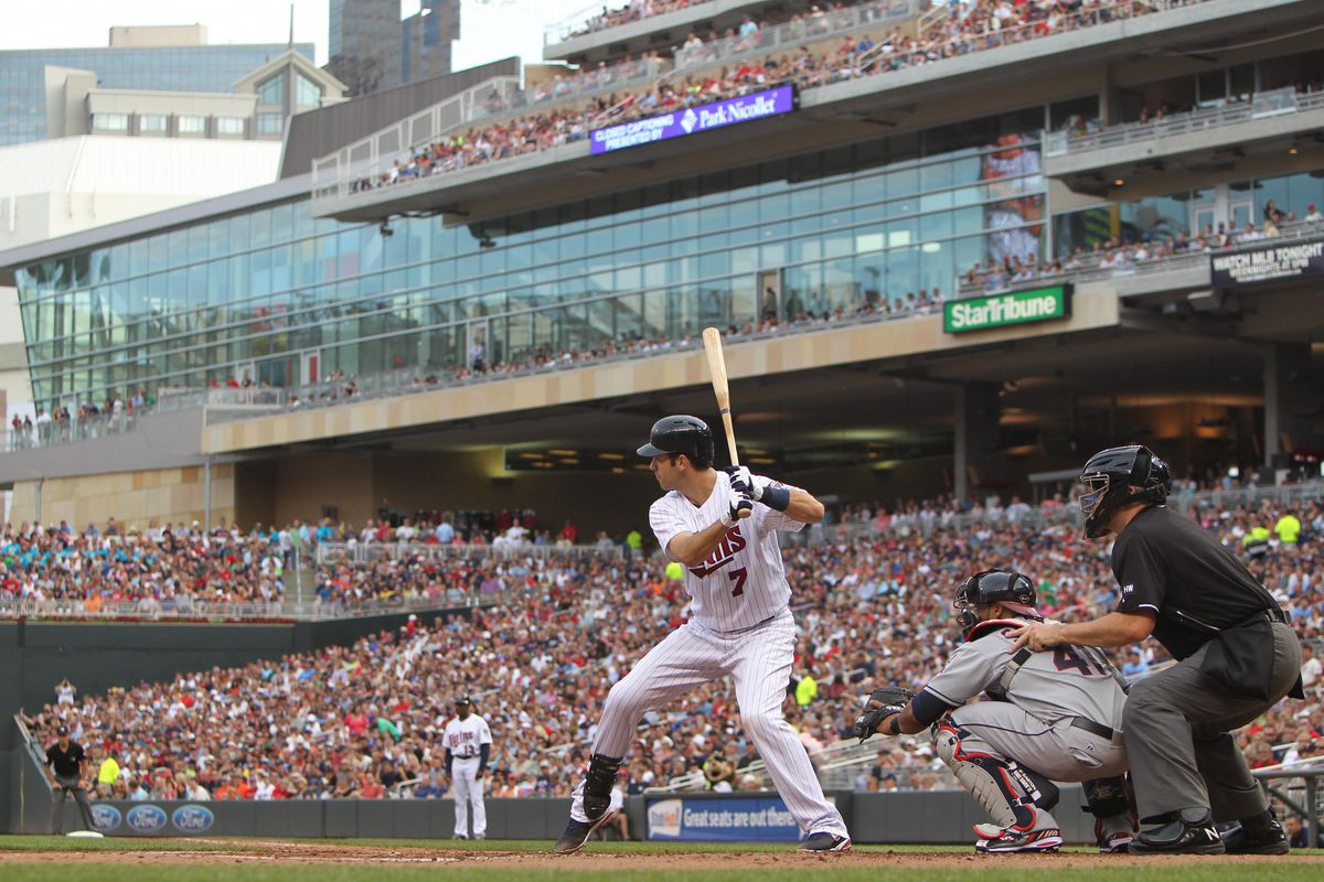 July 28, 2012; Minneapolis, MN, USA; Minnesota Twins catcher Joe Mauer (7) against the Cleveland Indians at Target Field. The Twins defeated the Indians 12-5. Mandatory Credit: Brace Hemmelgarn-US PRESSWIRE