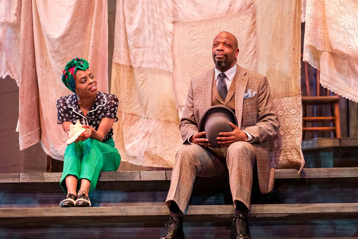 "Eben K. Logan as Celie and Melvin Abston as Mister in a scene from ""The Color Purple"" at Drury Lane Theatre."