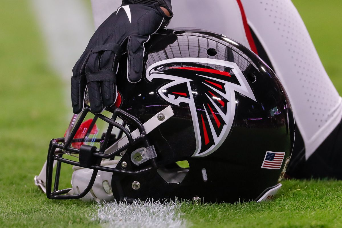 An Atlanta Falcons helmet on the field before the NFL football game between the Atlanta Falcons and the Arizona Cardinals on October 13, 2019 at State Farm Stadium in Glendale, Arizona.